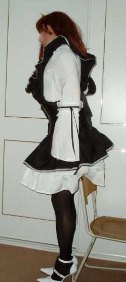 Gothic Maid Cosplay Costume, from the side. transgender transsexual cross dresser crossdresser bondage pictures stories fiction story